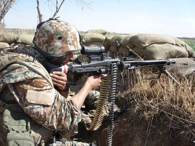 A Danish light machine gunner on operaion in Nad E Ali in Afghanistan's Helmand province.
